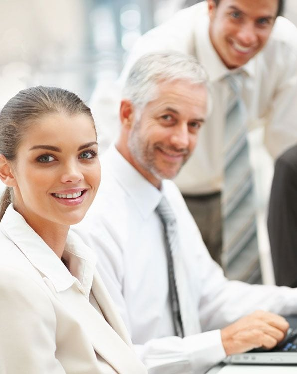 Team members smiling while in a meeting