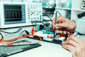 employee testing the electronic circuit