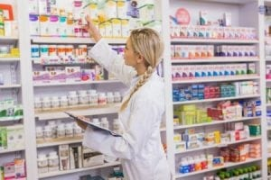 Employee counting stock in the Pharmaceutical store