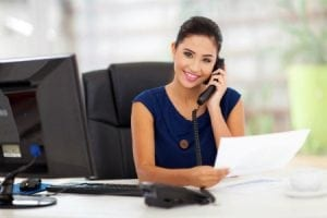 Administrative assistant making call
